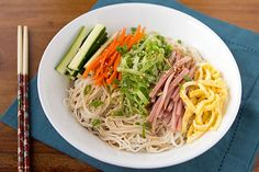 This cold somen noodle salad is a staple summer dish in Hawaii, where many Asian ingredients have become part of the island state's unique cuisine. When cooking somen noodles, you must watch them closely to make sure they do not overcook, immediately rinsing them under cold water to stop the cooking process.