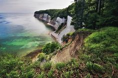 Nationalpark Jasmund by Kerstin Enderlein | White chalk cliffs in Jasmund National Park are famous landmarks and the most popular tourist attractions of the Rügen Island in Northern Germany. The tallest cliff is up to 161m high. Jasmund National Park has been established in 1990 and with only 30 km² it is the smallest national park of Germany. Jasmund National Park protects wild fascinating coast on the Baltic Sea with rugged white chalk cliffs and undisturbed beech woods.