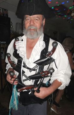 Here be Forrest Reed at the Pirates of the Estuary party in California wear arrrr the Black Beard bladric with 6 Queen Anne Pistols.