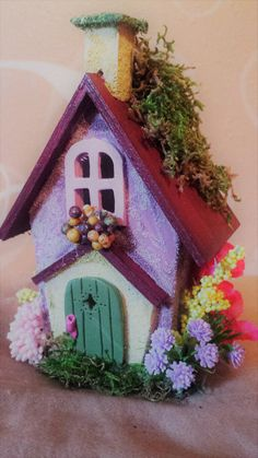 This adorable FAIRY SCHOOL HOUSE / CHURCH is perfect for a spring and summer garden. With all of the bright flowers in bloom at each side of the door and window box, fairies and pixies are sure to come and stay. Painted in pastel colors, this sweet little FAIRY HOUSE can be customized upon request and availability.  They stand 5 inches tall and are approximately 4 inches wide and 3 inches deep. Made with wood, sand, paint and fairy flowers. There are small pieces so not intended to be a ...