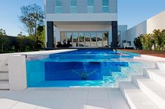 A pool with glass sides, one of which looks into the basement of the house - now I have to reconfigure my whole dream house floor plan. wishartrh desmondbulluck - check out more here -