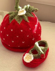 Oh! Soooo cute! Baby needs this set of strawberry booties and hat! Wish I knew how to knit!