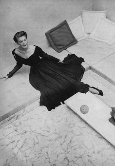 November Vogue 1948  by John Rawlings  Model is wearing a black rayon chiffon evening dress by Joseph Halpert.