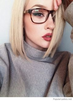 Short blonde hair, glasses and red lips