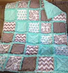 Ready to Ship    Here is a cute baby elephants rag quilt in turquoise and gray. It features baby elephants, chevrons and a damask print in flannels