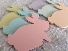 Paper bunny rabbit die cuts. Great for Easter egg hunts, spring parties or baby shower decorations.  These bunny rabbits are in sweet pastel