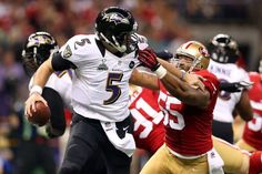 Images from Super Bowl XLVII(87 images)  Updated Feb 4, 2013 3:18 AM ET  At arm's length Joe Flacco (5) does his best to hold off a potential sack by linebacker Ahmad Brooks (55).    Christian Petersen - Getty Images