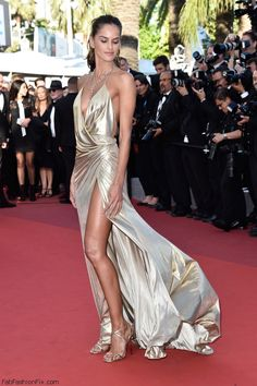 "Izabel Goulart stuns in Alexander Vauthier Couture golden dress at the ""The Last Face"" Premiere during the 69th annual Cannes Film Festival. #cannes #festivaldecannes #izabelgoulart"