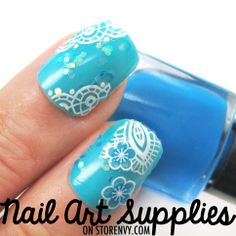 White Blue Contrasting Feather and Floral Nail Art Decal Salon Effect $1.99 #nails #manicure #fashion #beauty #glitter