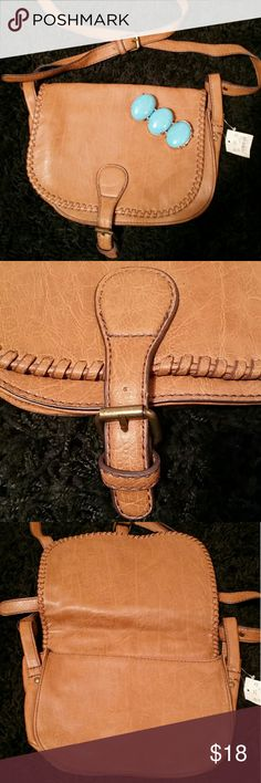 NWT American Eagle Purse Faux Leather NWT American Eagle Purse Faux Leather Crossbody. Turquoise bracelet not included but available for purchase in my closet! Color best shown in first set of pictures. Please ask questions before purchasing. American Eagle Outfitters Bags Crossbody Bags