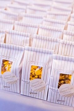 """""""I wanted to leave guests with a favor that was classic Chicago and that they could eat right away or for breakfast the next day,"""" Lauren says. """"We gave individual Garrett popcorn bags, with cute stickers that went with our stationery."""""""