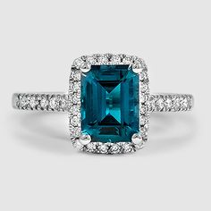 Our Odessa Diamond Ring set with an emerald cut emerald. #BrilliantEarth