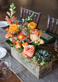 Try this unexpected take on a centerpiece: Plant your stems in aged, wood boxes. A mix of blooms and heights give this arrangement a relaxed, organic feel well suited for a rustic celebration. l TheKnot.com