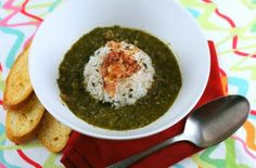 Trinidad Callaloo Soup | The flavor is wonderful- delicate but spicy, creamy, and rich with a flavor not unlike creamed spinach with a flair of curry and reminds me a little bit of a seafood gumbo.