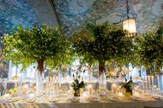 The outdoors were brought in with a ceiling full of foliage and large green centerpieces. Designed by celebrity event planner Jung Lee.