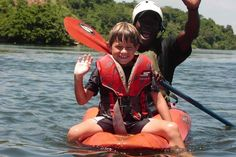 A little boy with a helper navigating Wild Waters, Travel Articles, Rafting, Uganda, Little Boys, This Is Us, How To Memorize Things, National Parks, Africa