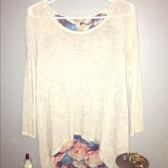 Cream top with floral back Super cute and feminine, EUC. Minimal signs of wear if any. No stains or tears, very lightweight and flowy.  Feel free to make an offer thru the offer button  Decree Tops