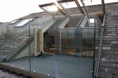 Maison avec fenetre sur le toit