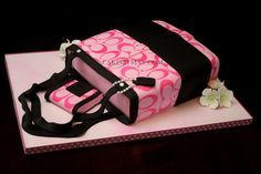@ Barb P. , Coach purse cake!  lol no cake but ill take a purse that looks like that