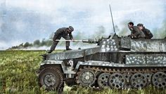 "A crew member cleaning the barrel of an Sd.Kfz. 251/9 - Schützenpanzerwagen (7.5 cm KwK 37 L/24) ""Stummel"" on the East Front, c. Summer 1942. (Colorized by Royston Leonard from the UK)"