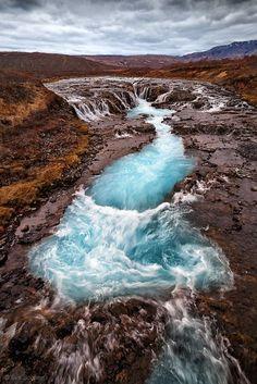 Admiring nature's beauty in Bruarfoss, Iceland.