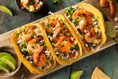 Buy Homemade Spicy Shrimp Tacos by on PhotoDune. Homemade Spicy Shrimp Tacos with Coleslaw and Salsa Simple Shrimp Taco Recipe, Spicy Shrimp Tacos, Shrimp Taco Recipes, Spicy Recipes, Lunch Recipes, Mexican Food Recipes, Cooking Recipes, Ethnic Recipes, Easy Recipes