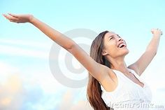 Happiness bliss freedom concept. Woman happy smiling joyful with arms up dancing on beach in summer during holidays travel. Beautiful young cheerful mixed race Asian Chinese / Caucasian female model outdoor.