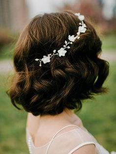 If you cut your hair in the months leading up to your wedding, style your bob with waves and a glamorous jeweled flower crown.