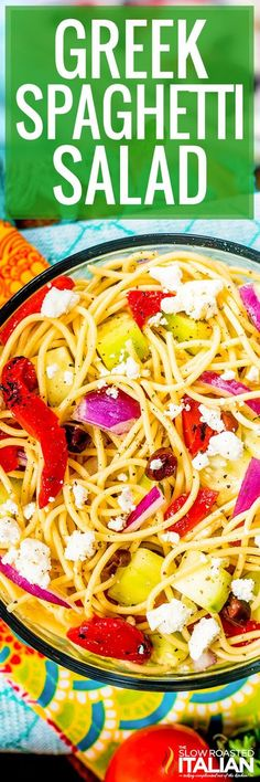 Greek Spaghetti Salad is an easy summer pasta salad recipe that comes together really quick. It is loaded with roasted red peppers, cucumbers, olives, and feta cheese, topped with a homemade Greek vinaigrette. It's my latest obsession! #theslowroasteditalian #tsri #salad #pastasalad #spaghettisalad #spaghetti #pasta #Greek #recipe