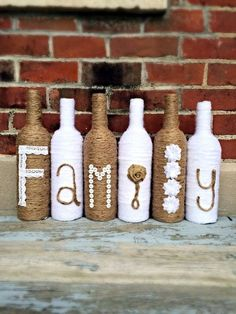 Family Twine Wrapped Wine Bottle Decor by BienzCraftBoutique… Wrapped Wine Bottles, Old Wine Bottles, Wine Bottle Art, Diy Bottle, Vodka Bottle, Recycle Bottles, Liquor Bottles, Glass Bottles, Perfume Bottles