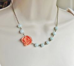 Coral and mint are super trendy this season. This necklace is a must have accessory for spring and summer. It makes a great bridesmaid necklace too. I used a coral colored rose cabochon that measures 22mm or approximately 3/4 and adorned it with very pale and translucent mint green glass beads. I also used antique brass chain and finished it with a lobster clasp. The total length of this necklace is 16 inches. Please let me know if you prefer a longer or shorter chain at checkout. ***If you…