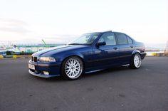 Blue Bmw e36 sedan on rondell 58 wheels