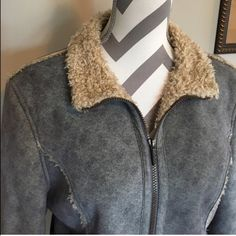 Cabela's Suede Jacket 🎉HP🎉 This is the most comfy warm jacket!! Suede on outside is a blue gray color. Inside is a super soft fuzzy material!! See last picture for what it is made of. Zipped up measurements are: armpit to armpit 18 in. 23 in long. Sleeves are 22 in long. Easy care machine wash!! Pockets on side. Barely worn!! Excellent condition!!🎉Host Pick Back to Basics @resthomas check out her awesome closet!! Cabela's Jackets & Coats