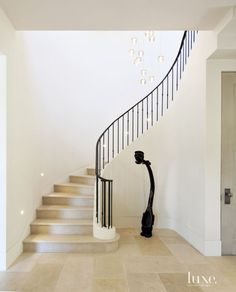 Transitional White Staircase with Steel Railing
