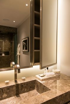 Swan neck rectilinear profile tap, PVD bronze mirror and cabinet framing, marble bathroom, Bedford Gardens, London UK