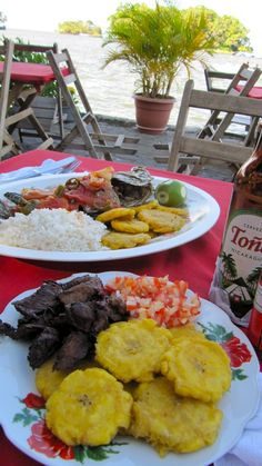Typical Nicaraguan lunch - Fresh fish, tostones, rice, beef, and cerveza. Granada, Nicaragua www.finisterra.ca