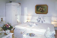 Schlafbereich in einer Ferienwohnung von Haus Midsommer.