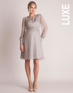 100% silk Elasticized back empire waist Blouson sleeves Keyhole detailing Length under-bust to hem: 26.8 inches / 68 cm (approx.) This luxurious polka dot maternity cocktail dress in pure champagne colored silk is perfect for the holiday season! Draping elegantly over your bump, this flowing knee-length style emphasizes your empire line, with a gently elasticized back seam, allowing the dress to adapt to your changing shape. The round neckline is enhanced by an alluring key hole detail...