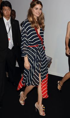 Olivia Palermo nailed the stripe trend in a chic Preen dress and statement Christian Louboutin heels.