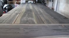 apple cider vinegar stain and steel-wool-infused stain for weathered wood....soak up to 2 weeks before using.