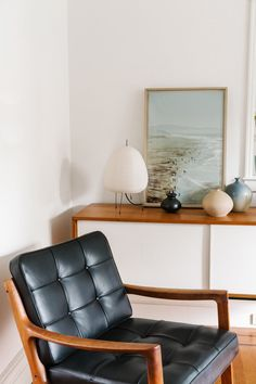 Love the color of the painting against the white and wood.  Would love a wall that color.