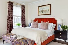 Summer Thornton Design, Inc. - bedroom with red upholstered bed and tribal pattern print draperies and bench