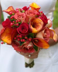 love the addition of the red hypericum berries this bouquet