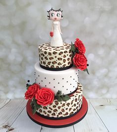 'Betty Boop' wedding cake with leopard print and red roses