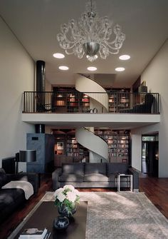 Large, double storey open plan living area with a spectacular circular staircase connecting the two floors.