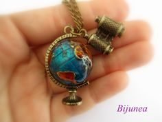 Globe necklace. Reminds me of Mrs. Frizzle.