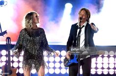 Recording artists Carrie Underwood (L) and Keith Urban perform onstage during the 52nd Academy Of Country Music Awards at T-Mobile Arena on April 2, 2017 in Las Vegas, Nevada.