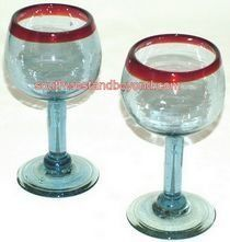 Mexican Bubble Glass - Mexican Glassware Pitcher Sets and Glasses . $20.00. Do you enjoy sipping brandy, cognac or whiskey? If so, then these are the perfect glasses for the true connoisseur. A clear glass with amber rim and base add to the beauty of these fine hand made bubble glasses. All glasses are sold in sets of two, so the price shown is for two glasses. Due to the hand made nature of our glassware please expect slight variations in size and shape.Height...