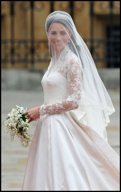 Princess Kate had a double whammy by not only having the classic veil over the face but a tiara, too!!