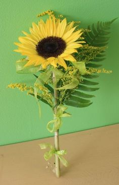 Single sunflower & fern boquet  for bridesmaids with peacock feathers as well though